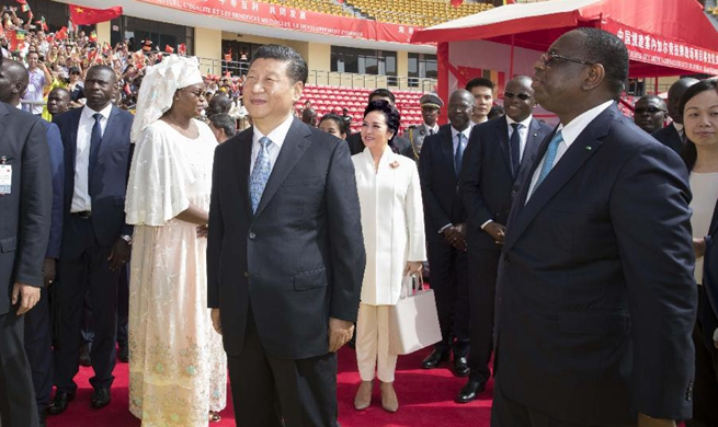 Xi attends handover ceremony of Senegal's national wrestling arena