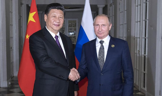 Xi, Putin exchange views on current int'l situation