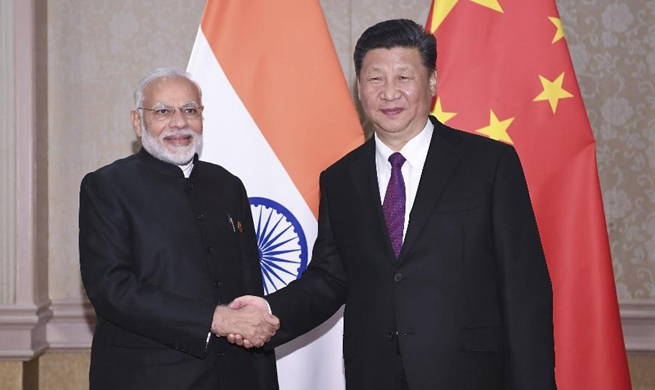 Xi says China to boost closer development partnership with India