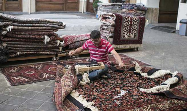 Iran to sue U.S. for banning imports of handwoven Iranian rugs