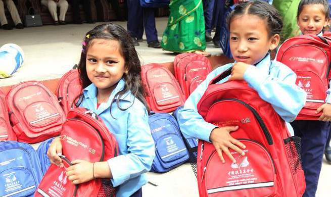 Chinese NGOs donate stationery, sports items to Nepali school