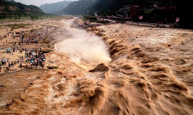 Aerial view of Yellow River's Hukou Waterfall in flood season in N China's Shanxi