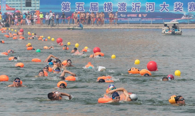 Swimming competition crossing Yihe River held in east China's Shandong