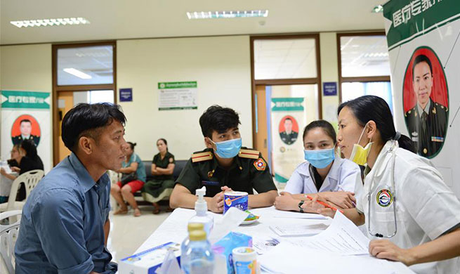 China's PLA Peace Train medical team provides treatment services in Laos