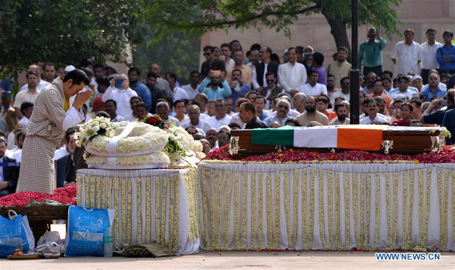 People attend cremation ceremony of former PM in New Delhi