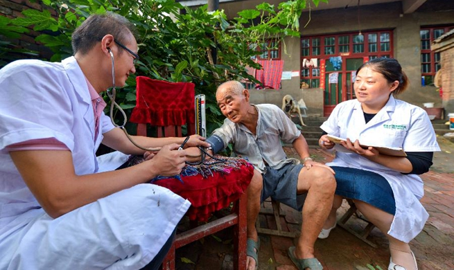 In pics: first Medical Workers' Day to be marked in China
