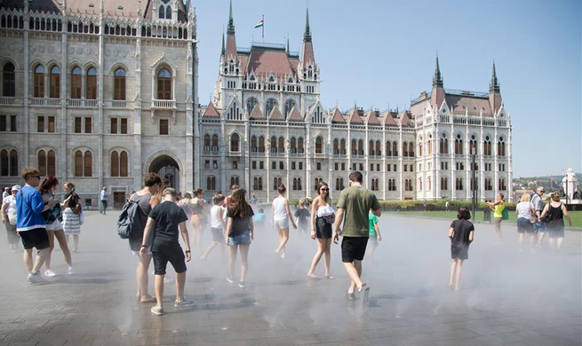 People cool off through sprays in downtown Budapest, Hungary
