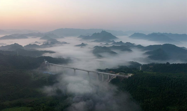 Xihuchong bridge of Qiangjiang-Zhangjiajie-Changde railway under construction in C China's Hunan