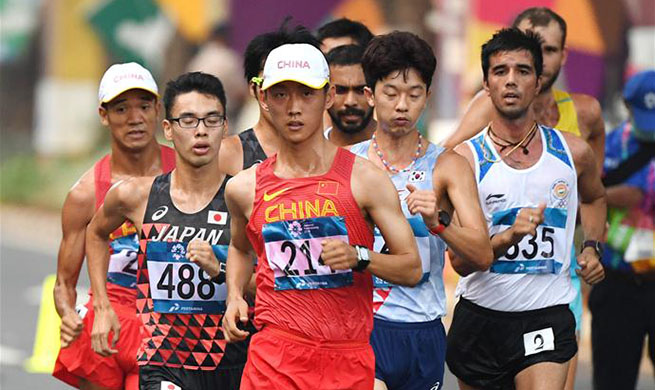 Wang Kaihua wins gold medal of men's 20km walk of athletics