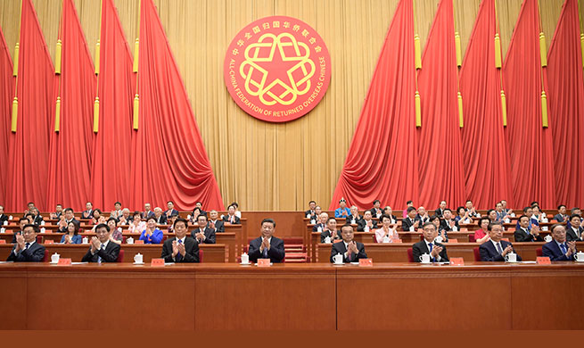 Top leaders attend congress of returned overseas Chinese