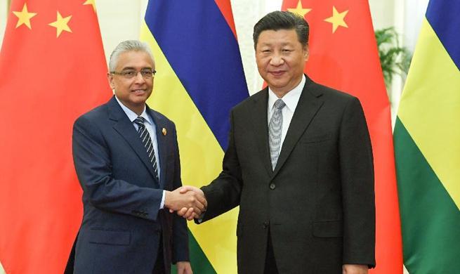 Xi meets Mauritian prime minister