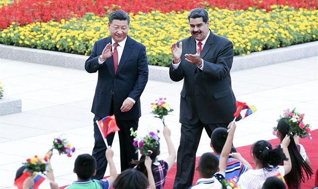 Xi, Maduro agree to promote bilateral ties to higher level