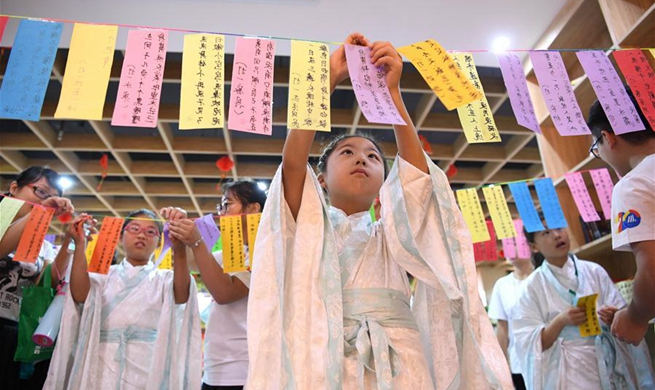 Children greet upcoming Mid-Autumn Festival in Hefei, E China