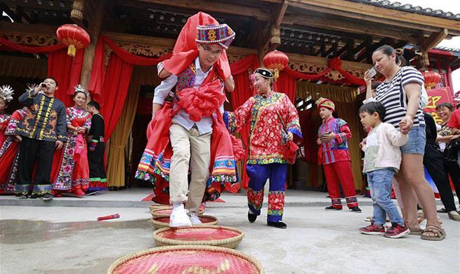 Tourists experience wedding custom of Tujia ethnic group in Zhangjiajie, China's Hunan