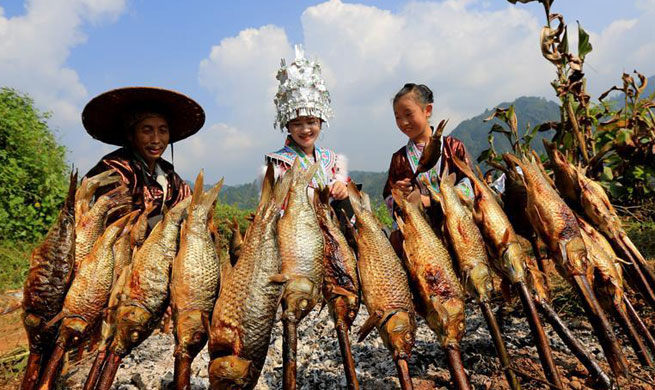 Miao ethnic group celebrate harvest in S China's Guangxi