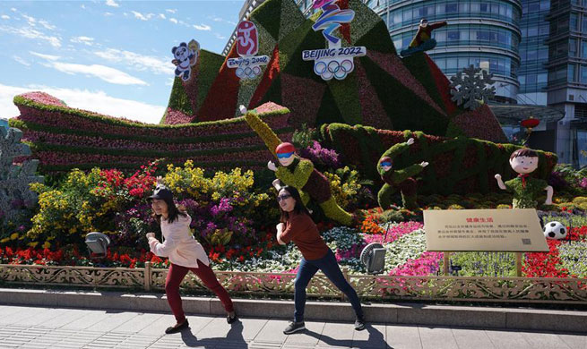 Beijing decorated with ornamental flower parterres for upcoming National Day