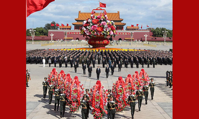 Chinese leaders pay tribute to national heroes at Tian'anmen Square