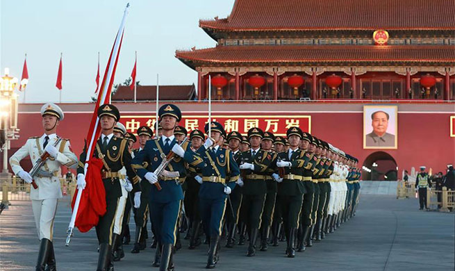 Flag-raising ceremony held at Tian'anmen Square to celebrate National Day