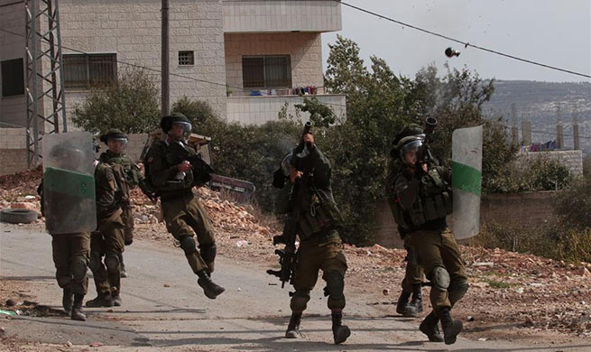 Clashes betweeen Palestinian protesters and Israeli soldiers break out near Nablus