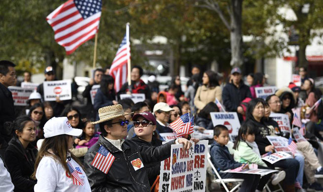 Hundreds of Asian Americans rally in Boston to back lawsuit over Harvard admissions