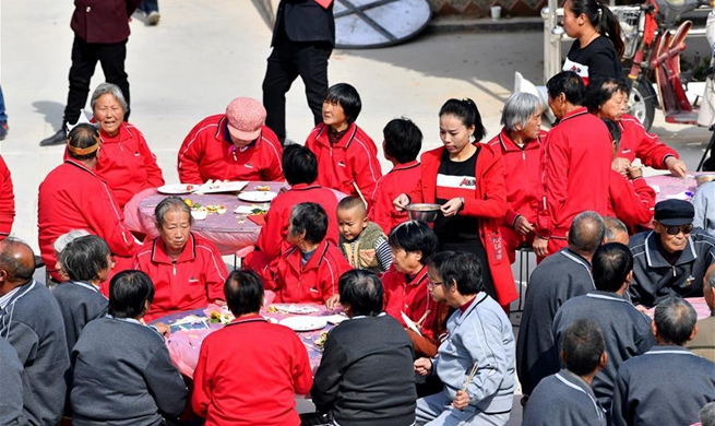 Seniors celebrate Chongyang Festival, poverty alleviation success in village of China's Shanxi