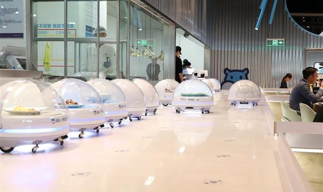 Robots serve food in Shanghai's smart restaurant