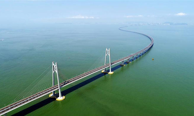 Xinhua Headlines: World's longest cross-sea bridge opens, integrating China's Greater Bay Area