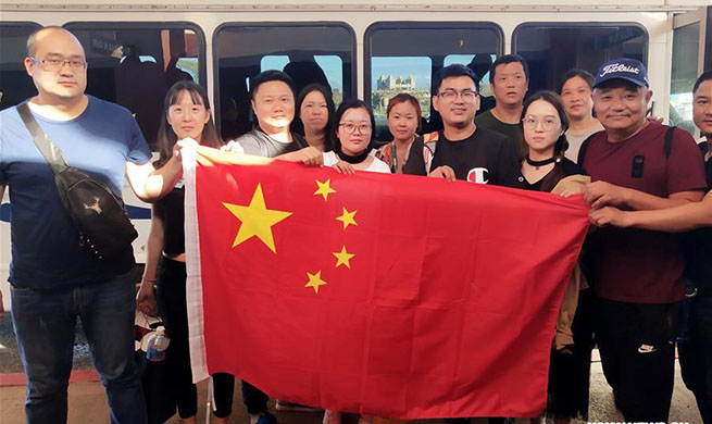 Typhoon-trapped Chinese tourists start to fly back home from Saipan