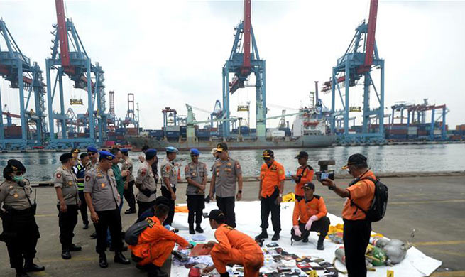 Indonesian rescuers retrieve 24 bags of body parts following plane crash