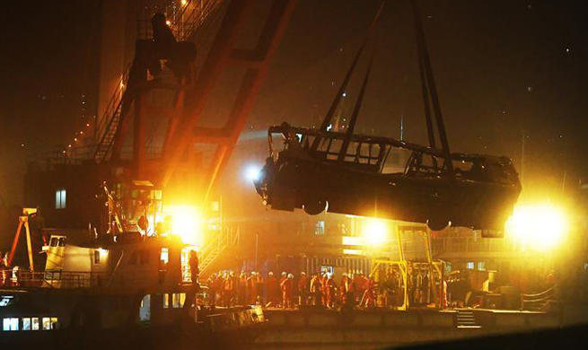Bus wreck retrieved from river in SW China