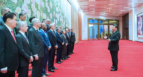 Xi meets foreign entrepreneurs attending CIIE