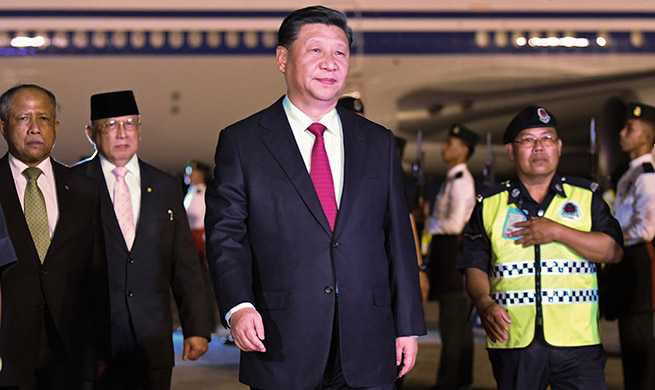 Xi arrives in Brunei for state visit