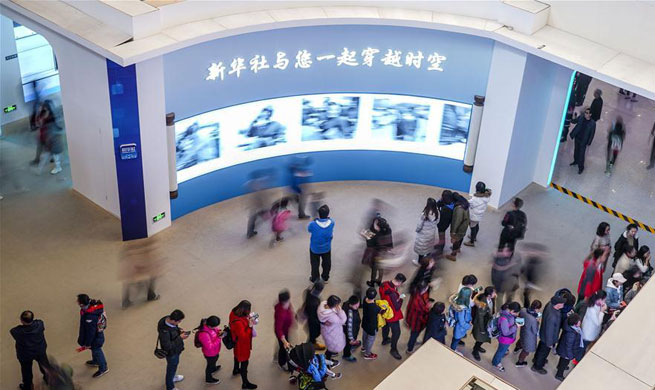 Visitors view exhibition commemorating China's reform and opening-up