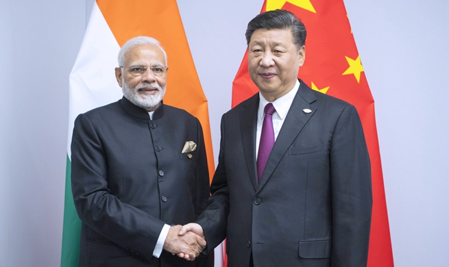 China, India agree to bring ties to higher level