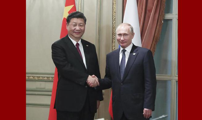 Xi, Putin meet on G20 sidelines