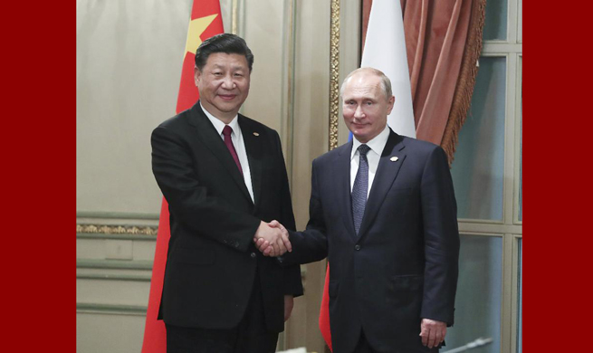 Xi, Putin meet on G20 sidelines
