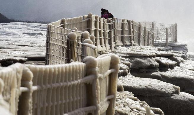 Breathtaking winter scenery of Hukou Waterfall