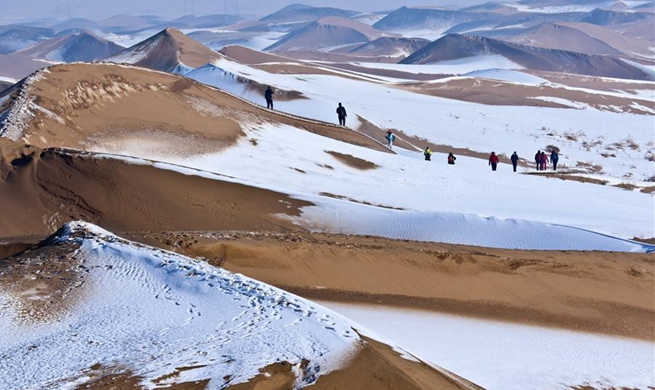 Snow scenery of Badain Jaran Desert in NW China's Gansu