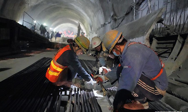 New Badaling tunnel of Beijing-Zhangjiakou high-speed rail line cut through