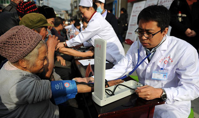 Villagers receive free health service in poverty-stricken areas in Guizhou