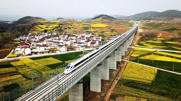 China to better balance environment protection, economic development
