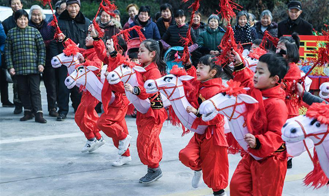 Children perform traditional folk dance to greet Spring Festival in China's Zhejiang