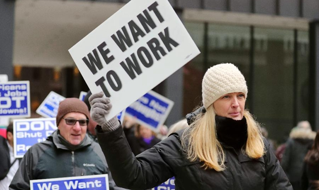 Federal employees, activists protest against government shutdown in Chicago