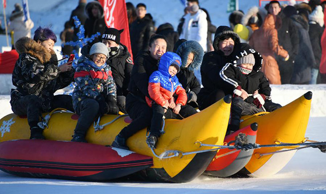 Tourists enjoy themselves on frozen Songhua River in China's Heilongjiang