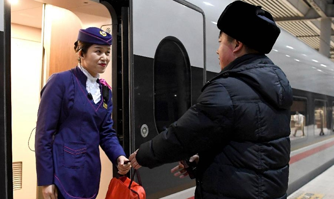 Couple working in rail dedicated to work during Spring Festival travel rush
