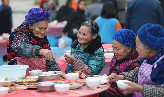 Residents of poverty-alleviation settlement enjoy meal to greet upcoming Spring Festival in China's Guizhou