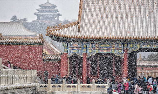 Visitors view snowy scenery at Palace Museum in Beijing