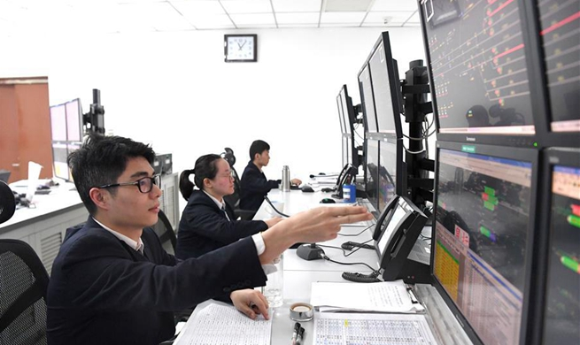 Staff members at Nanning East Railway Station busy working during Spring Festival travel rush