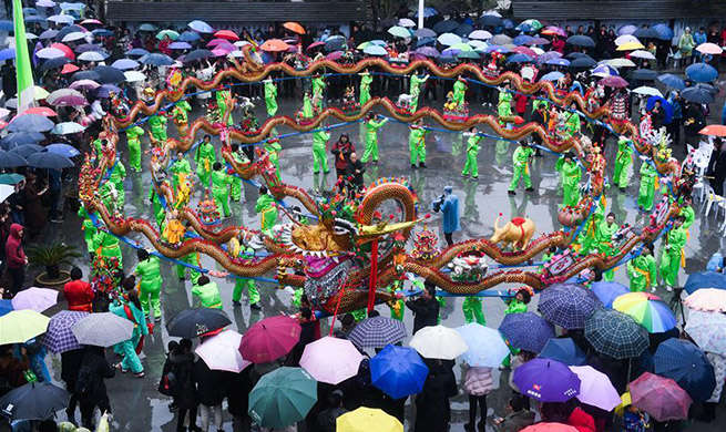 Wooden-bench dragon dance performed to celebrate Chinese Lantern Festival in east China's Zhejiang