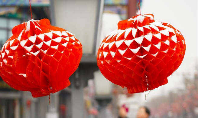 Lanterns covered by snow in Beijing on occasion of Chinese Lantern Festival
